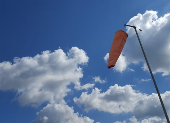 Windsock with cloud backdrop
